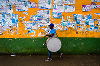 An Afro-Colombian drum player of the Pandeyuca neighborhood walks in front of the wall during the San Pacho festival in Quibdó, Colombia, 29 September 2019. Every year at the turn of September and October, the capital of the Pacific region of Chocó holds the celebrations in honor of Saint Francis of Assisi (locally named as San Pacho), recognized as Intangible Cultural Heritage by UNESCO. Each day carnival groups, wearing bright colorful costumes and representing each neighborhood, dance throughout the city, supported by brass bands playing live music. The festival culminates in a traditional boat ride on the Atrato River, followed by massive religious processions, which accent the pillars of Afro-Colombian's identity – the Catholic devotion grown from African roots.