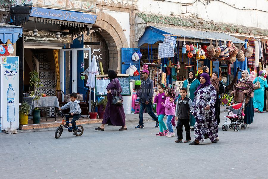 Essaouira, Morocco.  Women and Children Walking, Avenue de l'Istiqlal Street Scene.