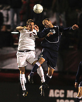 Jason Herrick #9 of the University of Maryland goes up for a header with Brian Forgue #13 of Penn State during an NCAA 3rd. round match at Ludwig Field, University of Maryland, College Park, Maryland on November 28 2010.Maryland won 1-0.