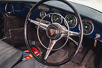 BNPS.co.uk (01202 558833)<br /> Pic: SilverstoneAuctions/BNPS<br /> <br /> Pictured: The steering wheel.<br /> <br /> A classic Porsche has emerged for sale after it was discovered in storage exactly as it was left over four decades ago.<br /> <br /> The 1964 3560C coup with its original blue paintwork is remarkably rare as most of its kind were scrapped after they were superseded by the more popular 911 model.<br /> <br /> Found by the seller in a barn where it languished since it was last driven in 1977, the car is a time capsule full of historic items left untouched for decades.