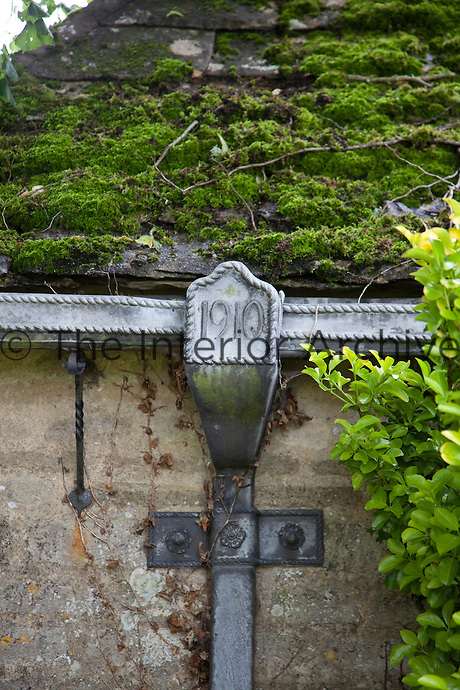 A hand-crafted lead drainpipe with the date the house was built