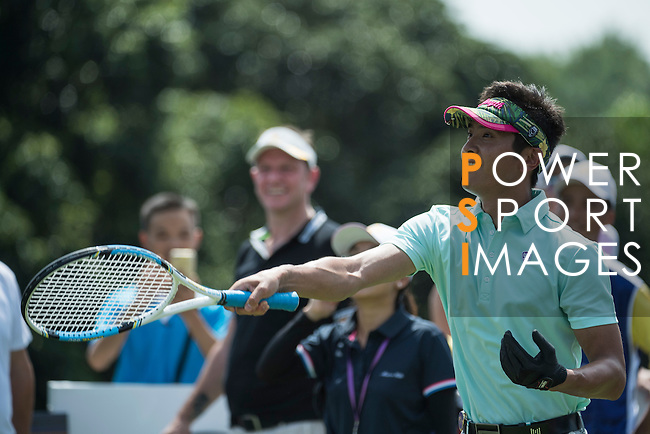 Xing Aowei plays tennis at the 10th hole during the World Celebrity Pro-Am 2016 Mission Hills China Golf Tournament on 22 October 2016, in Haikou, China. Photo by Weixiang Lim / Power Sport Images