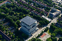 GERMANY Hamburg, IBA exhibition, an old war bunker from WW II is changed into an renewable energy project, with solar panels and solar thermal vacuum pipes / DEUTSCHLAND  Hamburg, Energiebunker Wilhelmsburg , IBA Projekt, Energieerzeugung aus Solarenergie, Biogas, Holzhackschnitzeln und Abwaerme aus einem benachbarten Industriebetrieb, der Energiebunker soll einen Teil des Reiherstiegviertels mit Waerme versorgen und gleichzeitig erneuerbaren Strom in das Stromnetz einspeisen. Der Energiebunker soll circa 22.500 MWh Waerme und fast 3.000 MWh Strom erzeugen. Das entspricht dem Waermebedarf von circa 3.000 Haushalten und dem Strombedarf von etwa 1.000 Haushalten, Solon PV Module an der Suedseite des ehemaligen Flakbunkers, auf dem Dach wurde von Ritter XL Solar Deutschlands groesste VakuumroehrenkollektorenAnlage zur Warmwassererzeugung installiert