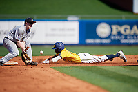 Michigan Wolverines right fielder Christan Bullock (5) steals second base as Josh White (3) takes the throw down during a game against Army West Point on February 17, 2018 at Tradition Field in St. Lucie, Florida.  Army defeated Michigan 4-3.  (Mike Janes/Four Seam Images)