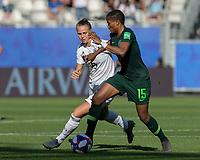GRENOBLE, FRANCE - JUNE 22: Rasheedat Ajibade #15 dribbles as Klara Buehl #19 defends during a game between Panama and Guyana at Stade des Alpes on June 22, 2019 in Grenoble, France.