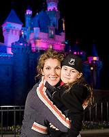 "Céline Dion (L) and son René-Charles, 6, outside Sleeping Beauty Castle at Disneyland in Anaheim, Calif. last week.  Dion and her family, are taking a short break from her smash Las Vegas show ""A New Day"", currently in its last year at Caesar's Palace. (CNW Group/Walt Disney Company Parks & Resorts)"