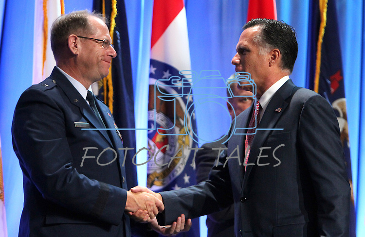Republican presidential candidate Mitt Romney thanks Brig. Gen. Bill Burks, NGAUS Vice Chairman and the adjutant general of Nevada, following Romney's speech at the 134th National Guard Association of the United States national convention in Reno, Nev., on Tuesday, Sept. 11, 2012..Photo by Cathleen Allison