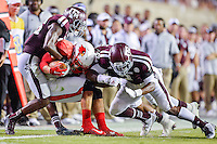 Lamar wide receiver Reggie Begelton (9) is brought down by Texas A&M defensive back Devonta Burns (26) and linebacker Tommy Sanders (3) during NCAA Football game, Saturday, September 06, 2014 in College Station, Tex. Texas A M defeated Lamar 73-3. (Mo Khursheed/TFV Media via AP Images)