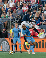 FOXBOROUGH, MA - SEPTEMBER 29: Jalil Anibaba #3 of New England Revolution and Heber #9 of New York City FC battle for the ball during a game between New York City FC and New England Revolution at Gillette Stadium on September 29, 2019 in Foxborough, Massachusetts.
