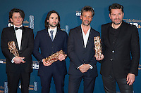 """French sound engineers Marc Engels, Fred Demolder, Sylvain Rety and Jean-Paul Hurier pose during a photocall after winning the Best Sound award for """"L'Odyssee"""" (The Odyssey) during the 42nd edition of the Cesar Ceremony at the Salle Pleyel in Paris on February 24, 2017."""