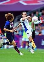 August 06, 2012..Japan's Aya Miyama #8 and France's Sonia Bompastor #8 during Semi Final match at the Wembley Stadium on day ten in Wembley, England. Japan defeats France 2-1 to reach Women's Finals of the 2012 London Olympics.