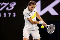 19th February 2021, Melbourne, Victoria, Australia; Daniil Medvedev of Russia returns the ball during the semifinals of the 2021 Australian Open on February 19 2021, at Melbourne Park in Melbourne, Australia.