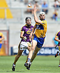 Conor Cleary of Clare in action against Liam Og Mc Govern of Wexford during their All-Ireland quarter final at Pairc Ui Chaoimh. Photograph by John Kelly.