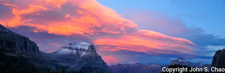 Panoramic of sunset highlighting clouds over Mount Cannon at Logan Pass, Glacier National Park, Montana.