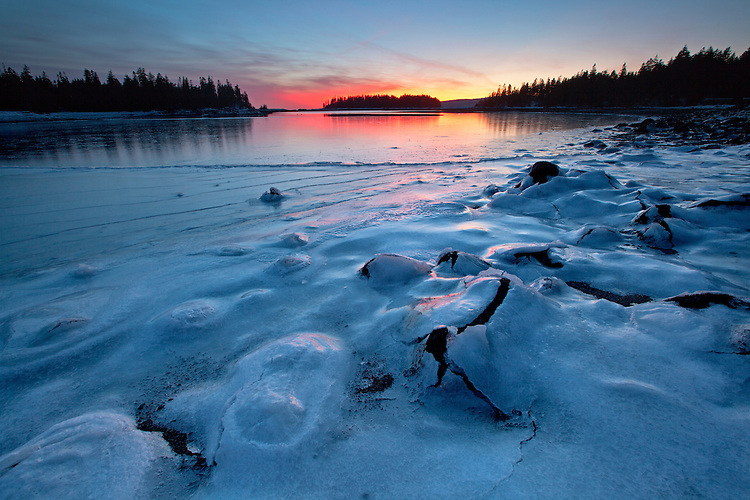 A sheet of ice covers the boulders in West Pond Cove during frigid weather on the Schoodic Peninsula, Acadia National Park, Maine
