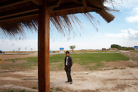 A tourist at the Zhalong Wetlands, Heilongjiang Province. China. 2011