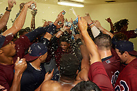 Mahoning Valley Scrappers celebrate in the locker room after winning the division title during the second game of a doubleheader against the Batavia Muckdogs on September 4, 2017 at Dwyer Stadium in Batavia, New York.  Mahoning Valley defeated Batavia 6-2 to clinch the Pinckney Division Title.  (Mike Janes/Four Seam Images)