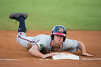 Drew Waters (12) of the Danville Braves slides head first into third base during the game against the Burlington Royals at Burlington Athletic Stadium on August 12, 2017 in Burlington, North Carolina.  The Braves defeated the Royals 5-3.  (Brian Westerholt/Four Seam Images)