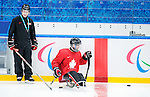 Sochi, RUSSIA - Mar 1 2014 -  Head Coach Mike Mondin and captain Greg Westlake of Team Canada hits the ice for their first practice before the 2014 Paralympics in Sochi, Russia.  (Photo: Matthew Murnaghan/Canadian Paralympic Committee)