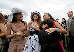 Winning rider John Velsaquez's family celebrates the win of Animal Kingdom, trained by Graham Motion, in the 137th running of the Kentucky Derby at Churchill Downs in Louisville, Kentucky on May 7, 2011.