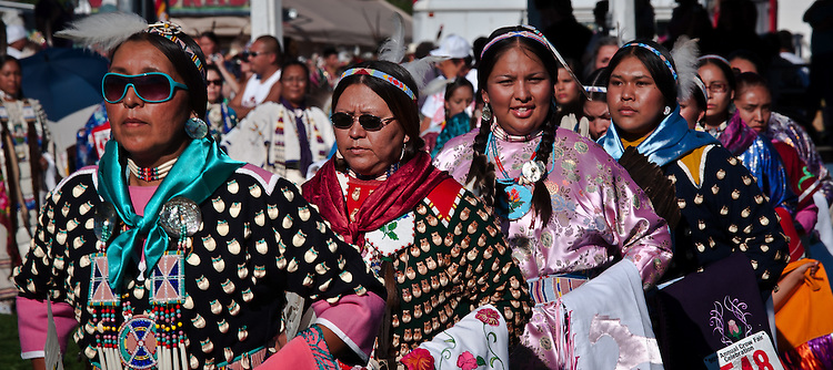 Women dancers enter the arena during the Grand Entry.