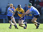 John Conlan of Clare in action against Ben Quinn and Shane Barrett of Dublin during their National Hurling League game at Cusack Park. Photograph by John Kelly.