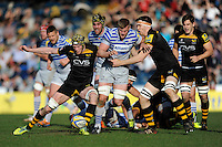 George Kruis of Saracens kicks ahead but is blocked by Kearnan Myall of London Wasps during the Aviva Premiership match between London Wasps and Saracens at Adams Park on Saturday 29th March 2014 (Photo by Rob Munro)