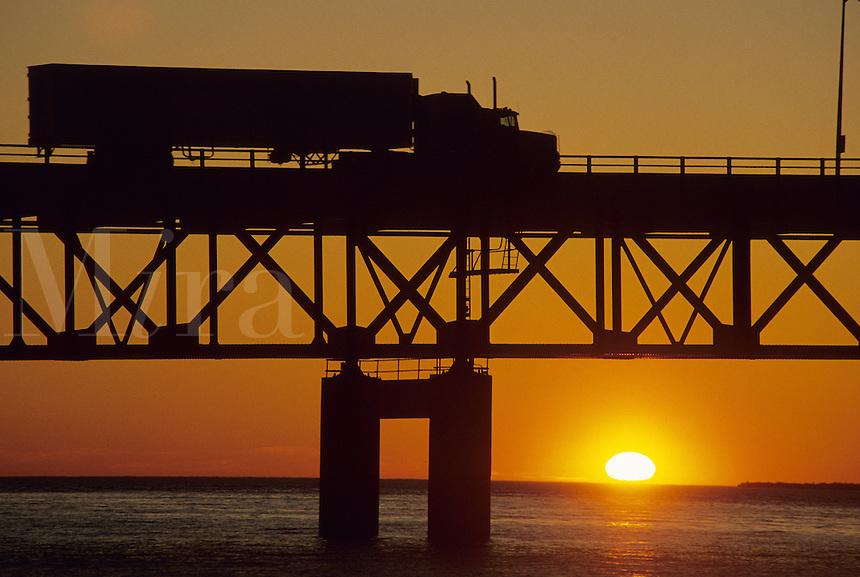 Truck moving at sunset on Mackinac Bridge, Michigan