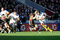 Fritz Lee of ASM Clermont Auvergne accelerates past Luke Wallace of Harlequins at the base of the scrum during the Heineken Cup Round 5 match between Harlequins and ASM Clermont Auvergne at the Twickenham Stoop on Saturday 11th January 2014 (Photo by Rob Munro)