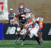 23 August 2008: Denver Outlaws' Midfielder Geoff Snider (7) checks Los Angeles Riptide Midfielder Chazz Woodson (3) during the Semi-Finals of the Major League Lacrosse Championship Weekend at Harvard Stadium in Boston, MA. The Outlaws edged out the Riptide 13-12, advancing to the upcoming Championship Game.. .Mandatory Photo Credit: Ed Wolfstein Photo