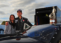 Sept. 5, 2011; Claremont, IN, USA: NHRA pro mod driver Eric Dillard (right) celebrates with wife Emily Dillard after winning the US Nationals at Lucas Oil Raceway. Mandatory Credit: Mark J. Rebilas-