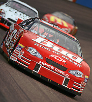 Dale Earnhardt Jr. leads a pack of cars through turn 2 during the Checker Auto Parts/Duralube 500K at Phoenix International Raceway in November 2000. (Photo by Brian Cleary/www.bcpix.com)