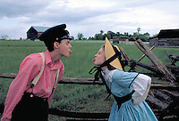 A brother and sister clad in Civil War Period costumes have some good-natured fun while teasingly sticking their tongues out at each other. Seen at the New Market Battlefield. New Market Virginia, New Market Battlefield.