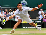 2ND JULY 2010, WIMBLEDON TENNIS CHAMPIONSHIPS, NOVAK DJOKOVIC IN ACTION AGAINST TOMAS BERDYCH, ROB CASEY PHOTOGRAPHY.