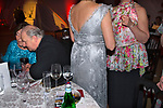 Rich wealthy elderly people private party couple whispering together. Hampshire England 2008