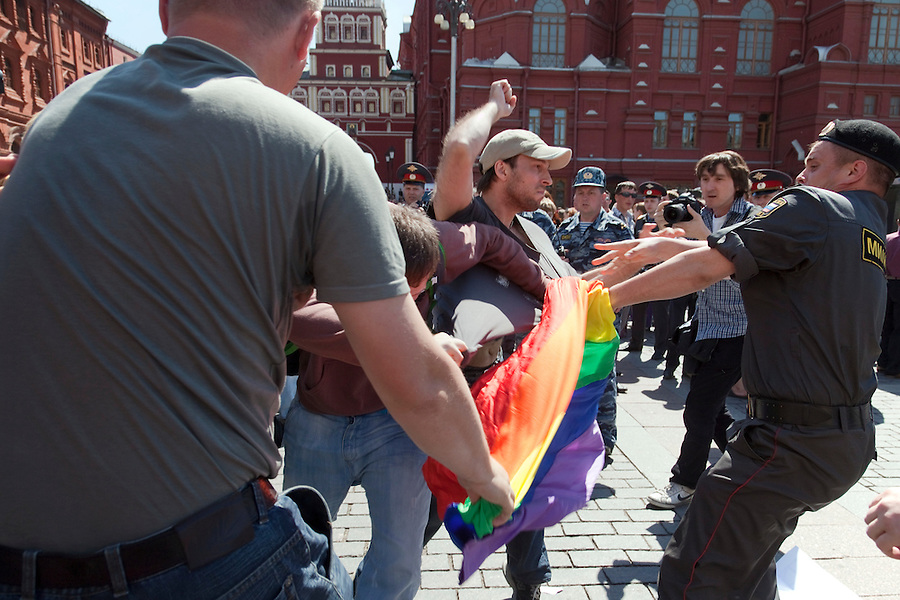 Moscow, Russia, 28/05/2011..A Russian nationalist throws a punch at a riot policeman trying to stop nationalists attacking a gay rights demonstrator. Several dozen people were arrested during clashes as Russian nationalists attacked gay rights activists during their sixth attempt to hold a gay pride parade in the Russian capital.