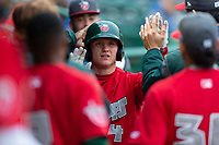 Fort Wayne TinCaps Nick Feight (2) is congratulated by teammates after scoring a run during a Midwest League game against the Fort Wayne TinCaps at Parkview Field on April 30, 2019 in Fort Wayne, Indiana. Kane County defeated Fort Wayne 7-4. (Zachary Lucy/Four Seam Images)