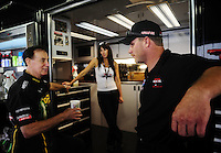 May 1, 2011; Baytown, TX, USA: NHRA sponsor and team owner Forrest Lucas (left) talks with funny car driver Brian Thiel during the Spring Nationals at Royal Purple Raceway. Mandatory Credit: Mark J. Rebilas-
