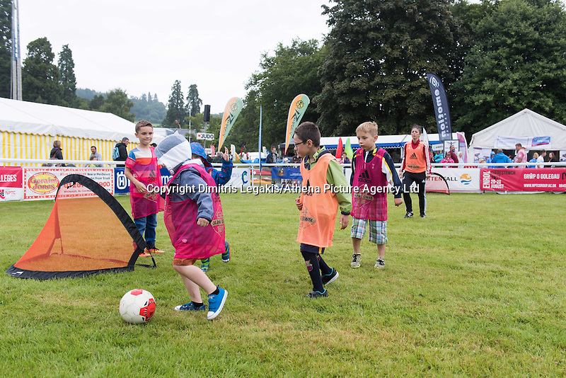 Pictured: Children playing football Monday 20 July 2015<br /> Re: Swansea City FC event at the Royal Welsh Show in Builth, Wells, mid Wales.