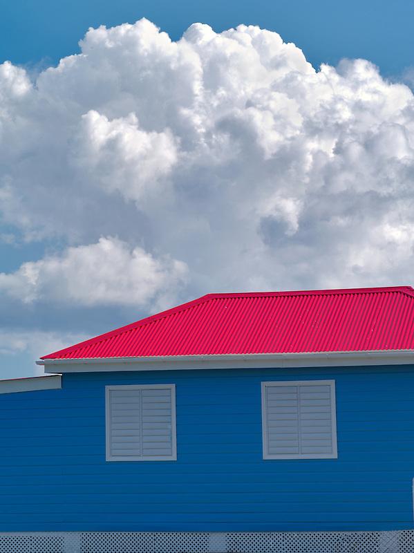 Colorful ferry building and clouds. Jost Van Dyke. British Virgin Islands