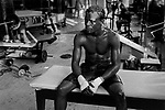 Ghanaian boxer Joshua Clottey  at rest during a training session at Gleason's Gym. Brooklyn , New York.   <br />Photo by Thierry Gourjon-Bieltvedt 1996.