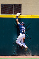 Outfielder Zach Kirksey #11 of the Ole Miss Rebels attempts to catch a TCU home run during the NCAA Regional baseball game against the Texas Christian University Horned Frogs on June 1, 2012 at Blue Bell Park in College Station, Texas. Ole Miss defeated TCU 6-2. (Andrew Woolley/Four Seam Images).