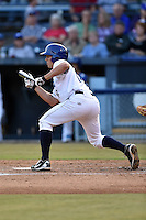 Asheville Tourists second baseman Michael Benjamin #18 squares to bunt during a game against the Savannah Sand Gnats at McCormick Field July 16, 2014 in Asheville, North Carolina. The Tourists defeated the Sand Gnats 6-3. (Tony Farlow/Four Seam Images)