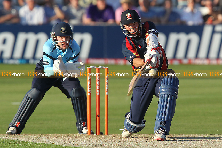 Graham Napier of Essex hits six runs for Essex as Ben Brown looks on - Essex Eagles vs Sussex Sharks - Friends Life T20 Cricket at the Ford County Ground, Chelmsford, Essex - 28/06/12 - MANDATORY CREDIT: Gavin Ellis/TGSPHOTO - Self billing applies where appropriate - 0845 094 6026 - contact@tgsphoto.co.uk - NO UNPAID USE.
