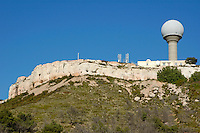 Meteorological station dome on a cliff top, Vitrolles, Provence, France.