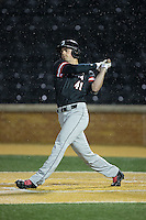 Will Robertson (41) of the Davidson Wildcats follows through on his swing against the Wake Forest Demon Deacons at David F. Couch Ballpark on February 28, 2017 in Winston-Salem, North Carolina.  The Demon Deacons defeated the Wildcats 13-5.  (Brian Westerholt/Four Seam Images)
