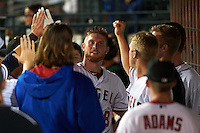Mesa Solar Sox catcher Stephen McGee (8) high fives teammates in the dugout after hitting a home run during an Arizona Fall League game against the Salt River Rafters on October 23, 2015 at Sloan Park in Mesa, Arizona.  Salt River defeated Mesa 5-1.  (Mike Janes/Four Seam Images)
