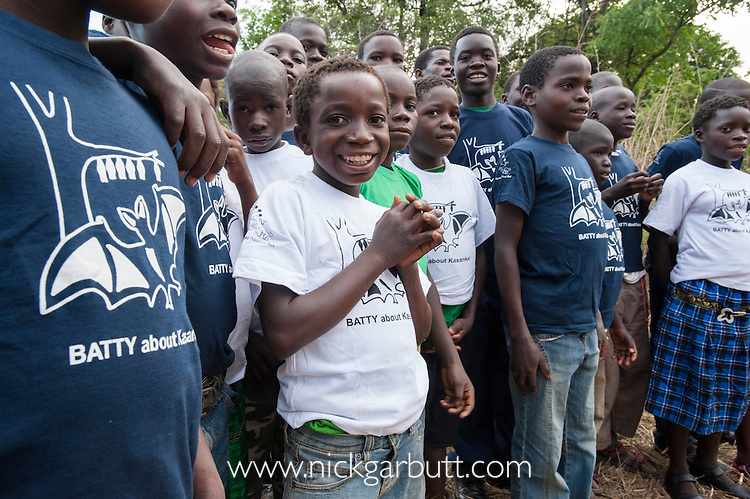 Local school children proudly wearing Kasanka Trust t-shirts on a visit to the Natioanl Park to see the mass aggregations of Straw-coloured Fruit Bat (Eidolon helvum).  Kasanka National Park, Zambia.
