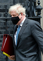 LONDON, UNITED KINGDOM - APRIL 27: British Prime Minister Boris Johnson leaves Downing St to attend the House of Commons for Prime Ministers Question Time in London, United Kingdom on April, 28, 2021. <br /> CAP/GOL<br /> ©GOL/Capital Pictures