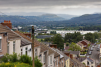 Pictured: Brecon Beacons summit and the Liberty Stadium as seen from Waun Wen Road where cars were set alight in Mayhill, Swansea, Wales, UK. Wednesday 16 June 2021<br /> Re: Riot aftermath in the Mayhill area of Swansea, Wales, UK.Pictured: Wednesday 16 June 2021<br /> Re: Riot aftermath in the Mayhill area of Swansea, Wales, UK.
